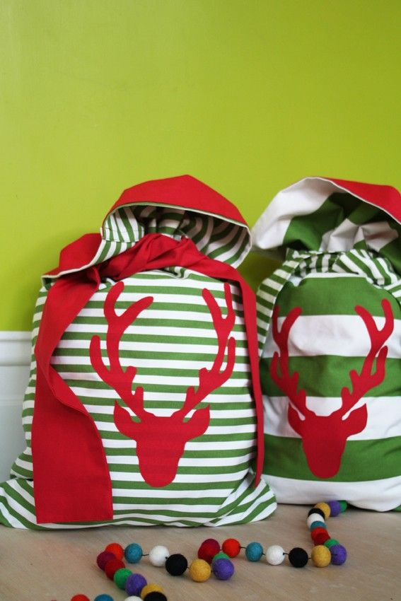 """""""Santa"""" bags for each children. They come with a note from Santa the first year and states that if they put them under the tree on Christmas Eve with two old/unused toys that could be refurbished, he will bring them new ones in their bags. No wrapping paper. We even remove all of the packaging and put the batteries in or charge what needs charged."""
