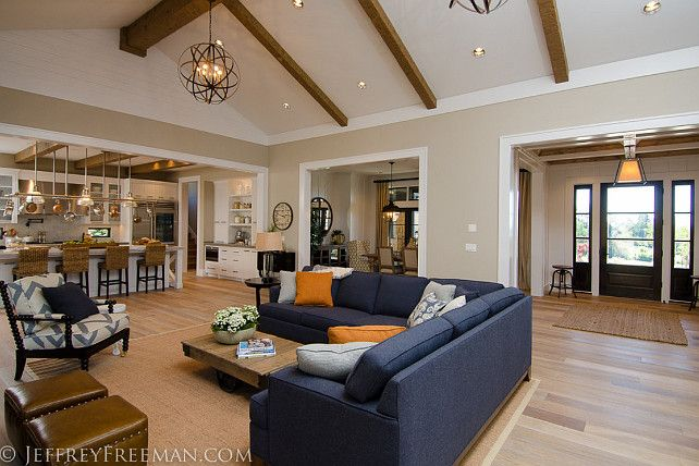 """The entire main floor feels connected thanks to its open floor plan. Spindle chairs is the """"Old Hickory Tannery 'Ellsworth' Spindle-Back Chair"""" by """"Horchow""""."""