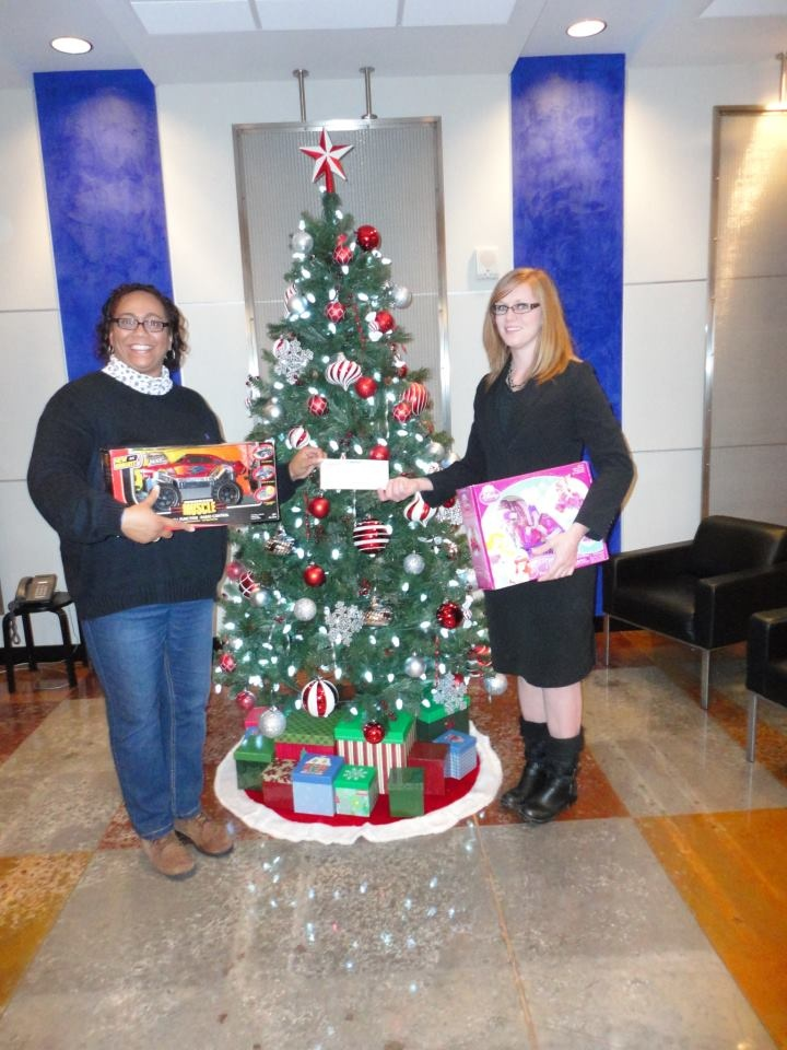 Warrantech collected over 100 toys and gifts, plus $235 in donations, during our recent toy drive to benefit the families of the 370th Chemical Company of the U.S. Army Reserves. In addition to the contributions of our employees, the company also donated $500 worth of toys to our own Jillian Robinson and her fellow reservists (shown on the right, accepting the cash donations and some toys from Darla Stewart, the event's administrator).