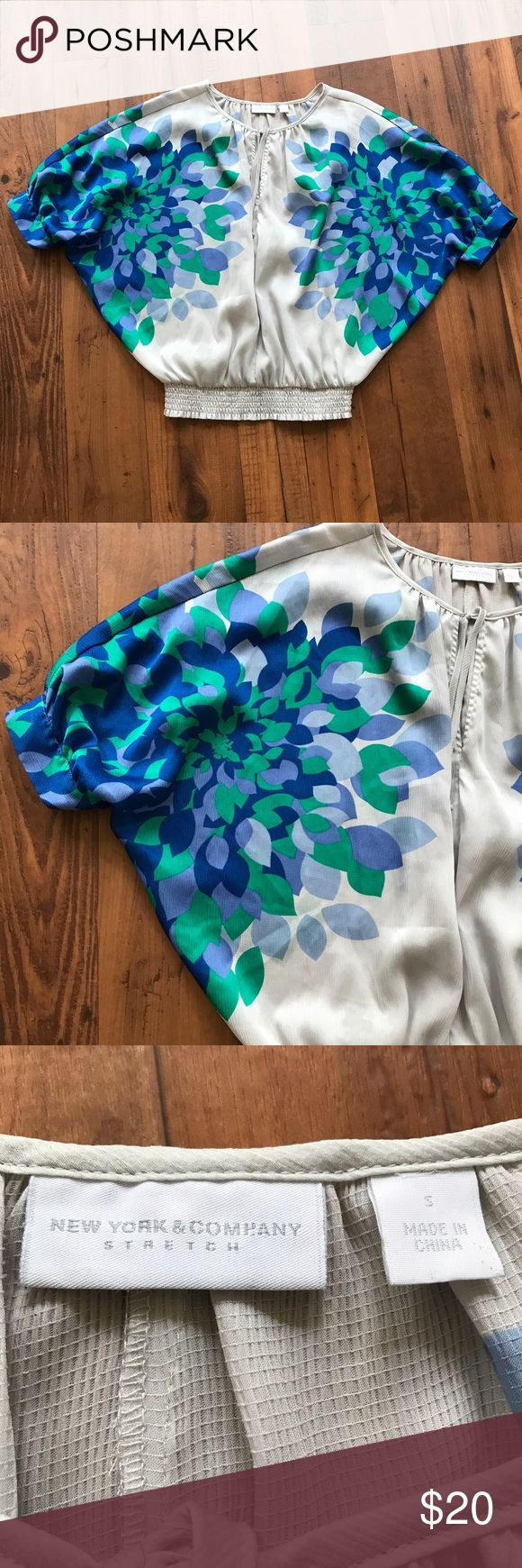 """New York & Company Batwing Dolman Floral Top New York & Company batwing dolman green and blue floral top. Cinched elastic waist. Peep hole on the front. Size small. The length of the top is about 23"""". New York & Company Tops Blouses"""