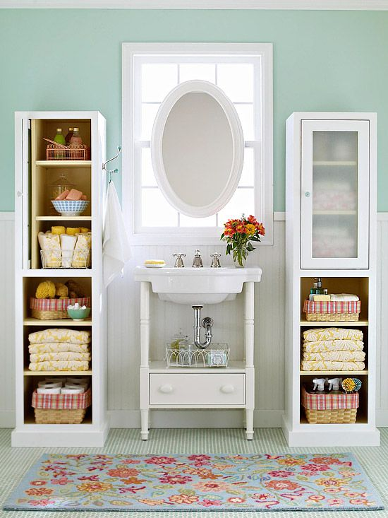 Storage towers on either side of a sink are a quick  way to add organization to a teensy apartment bathroom.