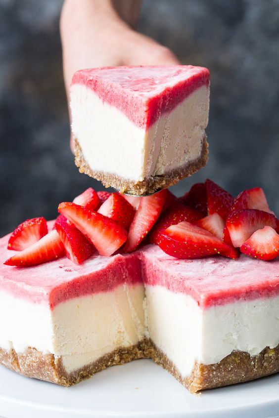 This no-bake Paleo and vegan cheesecake has a chewy, naturally sweet crust, topped with a thick creamy lemon layer and a sweet creamy strawberry layer. The cheesecake layers have a cashew base, come together quickly in a blender or food processor, and are then chilled to set. Gluten free, dairy free, refined sugar free.