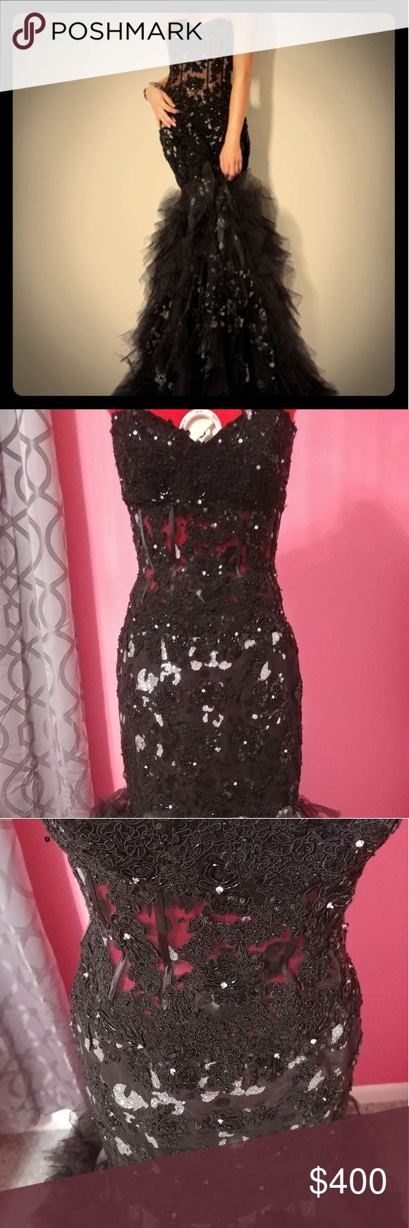 Stunning jovani black mermaid gown size 6 Jovani 172008. Google this dress and see how flattering it is on real girls, absolutely breathtaking, you will stand out anywhere. Sheer bodice that looks like a corset and has boning that will shape the midsection. Bottom is fluffy tulle material. Worn once for pictures. Make sure to look up Jovani' s prom size chart. Jovani Dresses Prom