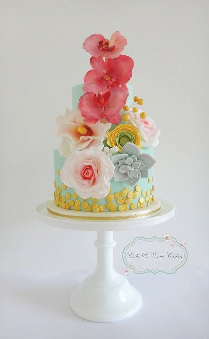 Cake matching the boquets.. I don't know about the colors on this but the idea is awesome!