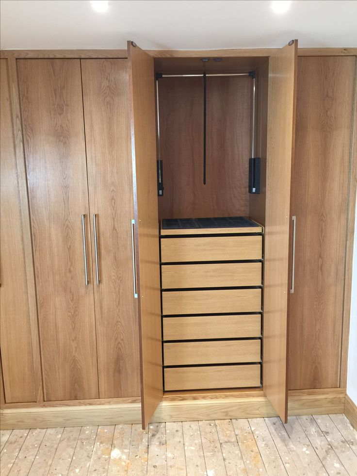 Attic built in wardrobes open showing IKEA drawers fitted into our own cabinets. Spring loaded ...