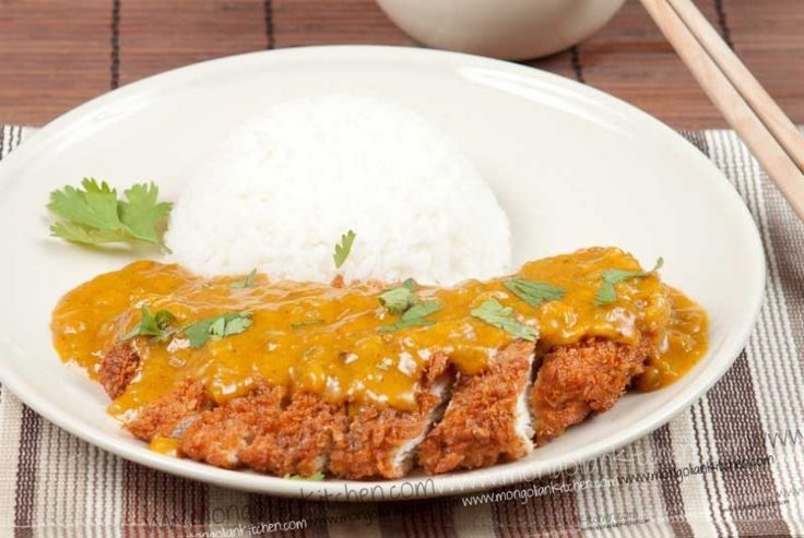 katsu chicken. atsu Chicken is a popular takeaway dish involving chicken, deep fried in fluffy Japanese panko breadcrumbs and topped with a mildly spiced Japanese Curry sauce.