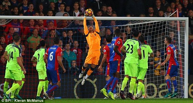 The German goalkeeper stretches to make a save during his side's game at Crystal Palace
