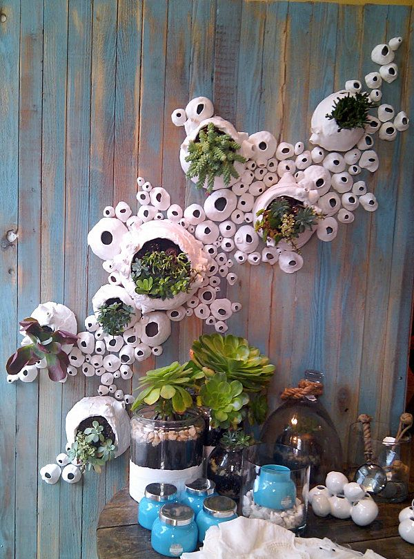 20 Store Displays That Showcase Amazing Design - Anthropologie store display featuring plants