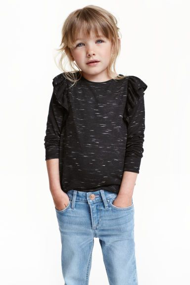 £6 Frilled top | H&M  http://www2.hm.com/en_gb/productpage.0429250003.html