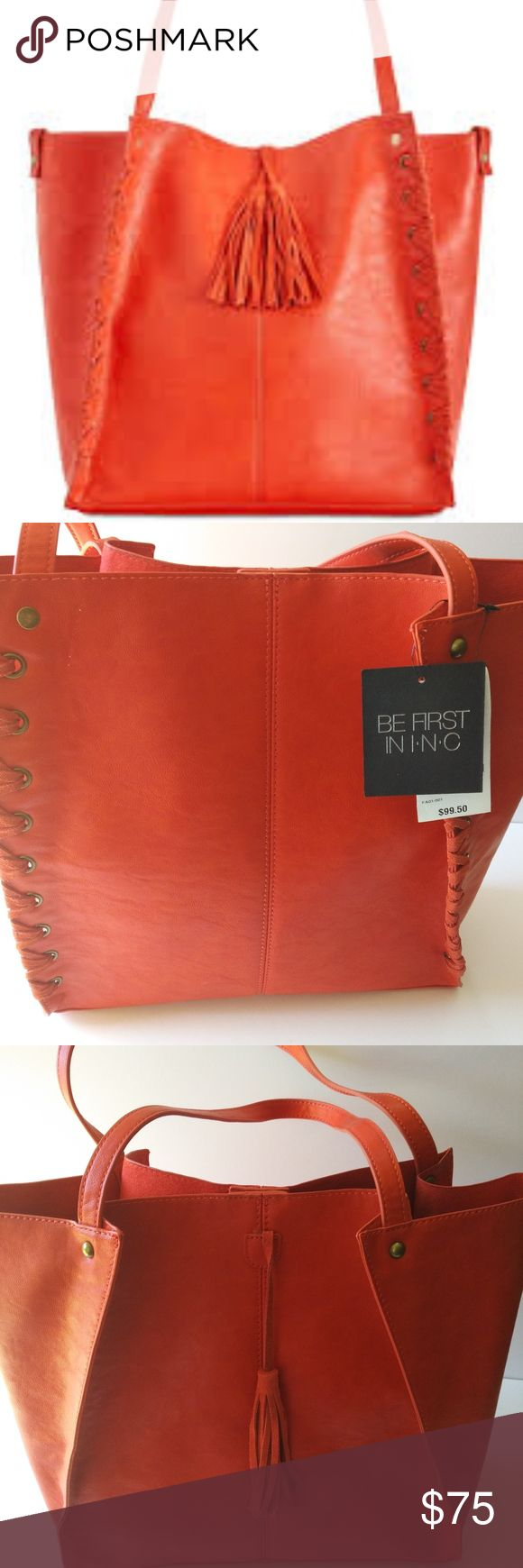 Venice Whipstitch Medium Tote Coral A large removable pouch organizes a INC International Concepts tote laced up the sides and finished with suede tassels for a touch of Western charm. Snap closure. New With tags INC International Concepts Bags Totes