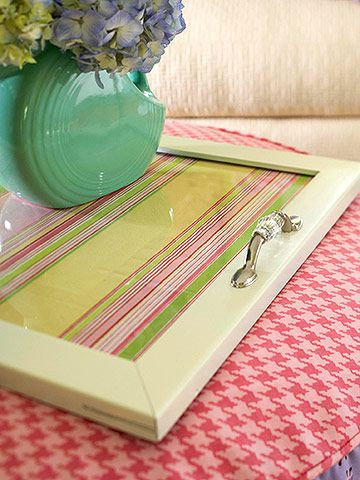 Attach handles to an old picture frame, place fabric or patterned wrapping paper under glass, and you have a picture-perfect serving tray! Functional and fabulous! So doin this for my apt next year!