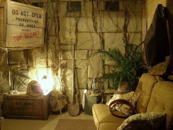 "Indiana Jones Room, This room is a tribute to the greatest adventurer of all time Indiana Jones. The room was made to look like a long abandoned South American dig site. Indys ""top secret"" create holds a flat screen T.V. and treasure from past adventures. , Patios & Decks Design"