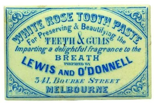 "WHITE ROSE TOOTH PASTE FOR PRESERVING & BEAUTIFYING THE TEETH & GUMS IMPARTING A DELIGHTFUL FRAGRANCE TO THE BREATH PREPARED BY LEWIS AND O""DONNELL 341 BOURKE STREET MELBOURNE BLUE CERAMIC LID"