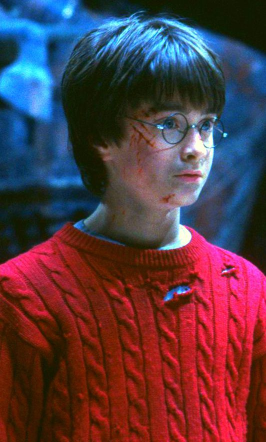 Harry Potter. Just look at him though!!! Eleven years old and so beat up looking, not from a fight with a kid on a playground but in a mission to save the school from Voldemort.