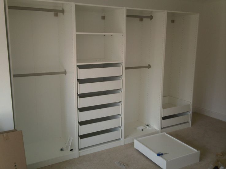 Four Ikea wardrobes being assembled by Flatpack Assembly Suffolk. With drawers and sliding doors these take about six hours, or £180.