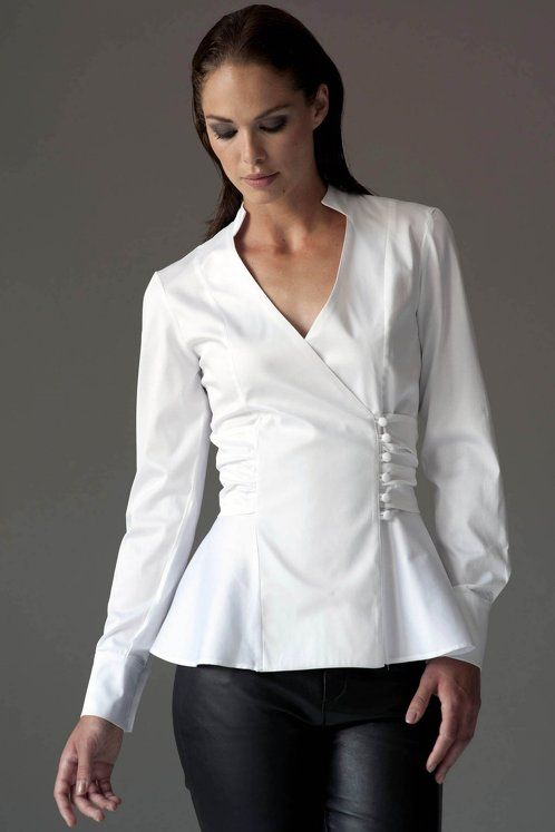 https://www.cityblis.com/6074/item/12532   JOSEPHINE WHITE - $136 by The Shirt Company   The Josephine shirt is a chic way to work fashion's penchant for peplums. Contrast the flared silhouette with a sleek pencil skirt for a sophisticated look.  Featuring a belted waist and covered buttons this beautiful shirt will give a shapely feminine look.  White Cotton Sateen:  96% Cott...   #Tops/Blouses