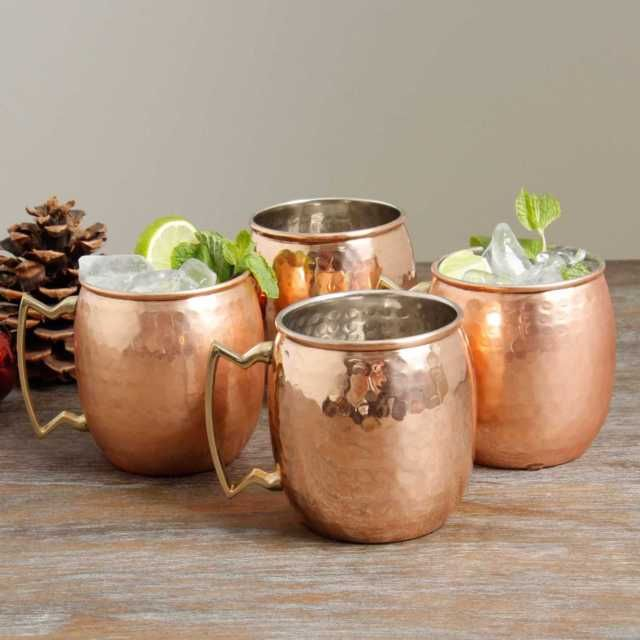 16-oz. Hammered Old Dutch Copper Moscow Mule Mugs with Brass Handles - Set of 4   Mix up classic Moscow Mule and more with the help of these 16 oz. Hammered Copper Moscow Mule Mugs with Brass Handles! The traditional spicy ginger and lime vodka cocktail has been classically served in copper mugs since the 1940's, although these insulating mugs are also ideal for any hot or cold beverage you prefer.