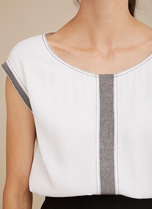 Blusa combinada con pespuntes
