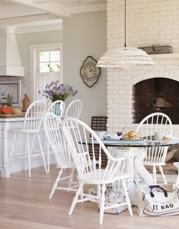 Love the white painted chairs.
