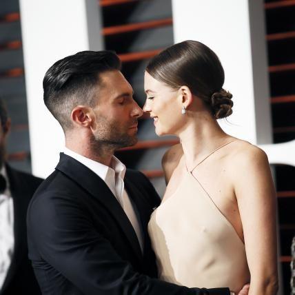 Behati Prinsloo Levine and Adam Levine | Adam Levine and Behati Prinsloo's Cutest Couple Moments of 2015 from InStyle