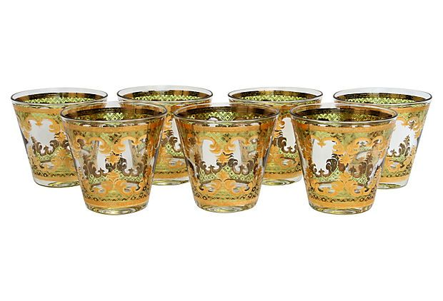 "George Briard Cocktail Glasses, S/7 on OneKingsLane.com described by Viridian Set of seven midcentury cocktail glasses, each decorated with gold feather and medallion motif in brilliant green and gold with ""Georges Briard"" signature down the side. Discontinued pattern, circa 1960."