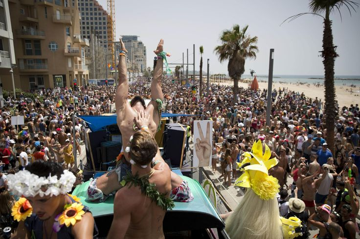 TEL AVIV, Israel (AP) — Colorfully-dressed drag queens and bare-chested muscular men on floats partied alongside thousands of others from the LGBT community at Tel Aviv's annual gay pride parade on Friday, the largest event of its kind in the Middle East.