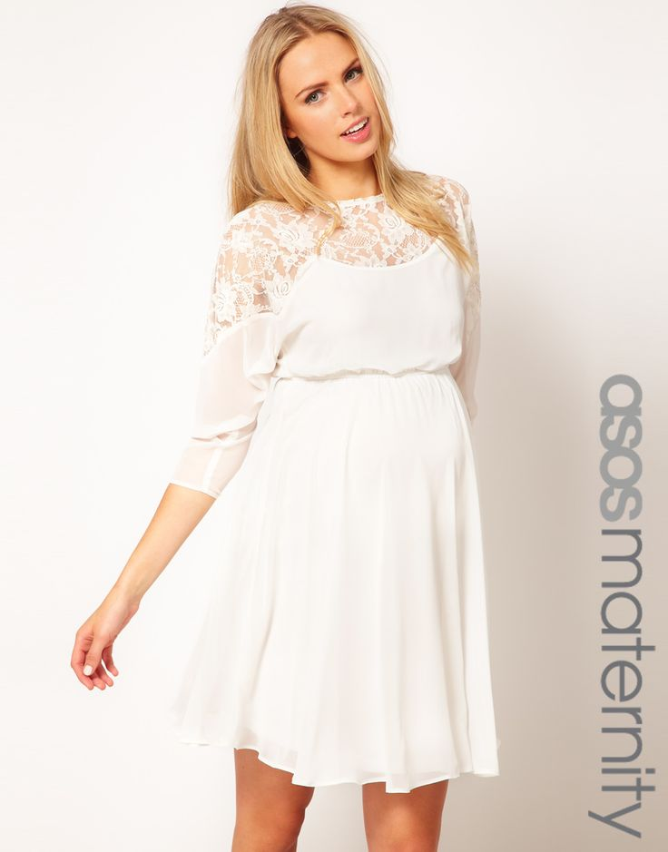 Mallory, We're you looking perhaps for something similar to this for the photo shoot? Could be cute! white lacy maternity dress $45,