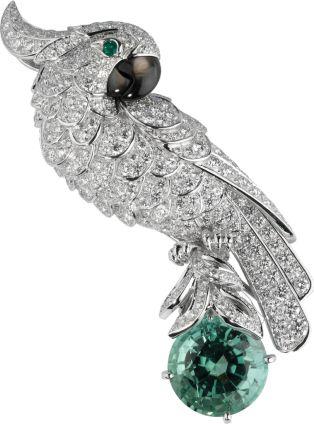Cartier Fauna and Flora brooch Platinum, white gold, green tourmaline, diamonds, emeralds, mother-of-pearl