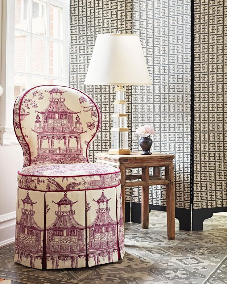 Instagram, gorgeously upholstered vanity stool, chinoisserie toile featuring reddish purple pagodas on a ground of off white or light yellow, short of the still is perfectly pleated, piping at seams