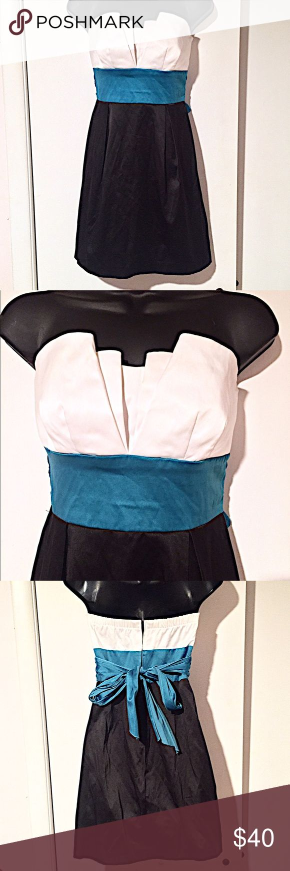 """🎉Strapless Party Dress🎉 Strapless party dress. White top with folded detail bust area, black bottom, and turquoise sash that ties in the back. Zip back closure with elastic throughout the top back area. Bust width 13"""" laying flat off the mannequin, can stretch to 17"""" from elastic. Length is 25"""". Only Worn Once! PERFECT CONDITION! Very comfortable and easy to wear! Teeze Me Dresses Strapless"""