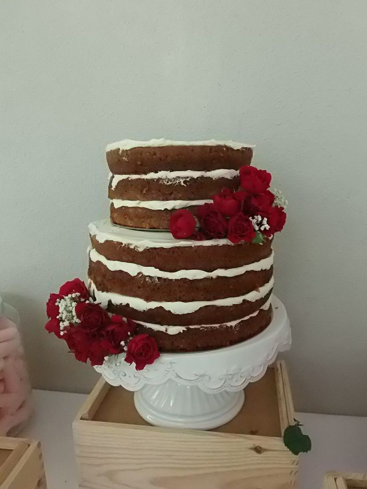 Naked carrot cake with red roses