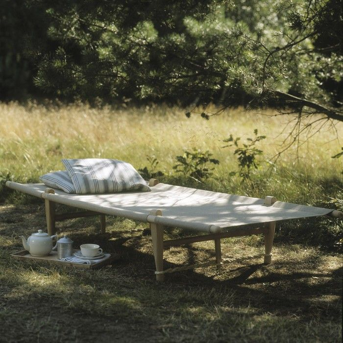 """Designed by the director of a Danish technical college to be """"as comfortable as a real bed,"""" Manufactum's beechwood folding bed is also one of the most stylish cots we've seen. Made from a solid wood frame with linen flax bed and carrier bag; €380."""
