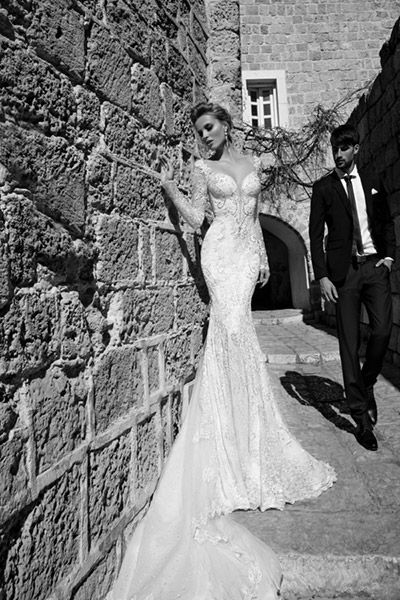 Mermaid wedding gown by Galia Lahav with long lace sleeves, exaggerated sweetheart neckline, natural waist, bedazzled bodice, lace mermaid skirt, and cathedral lace train