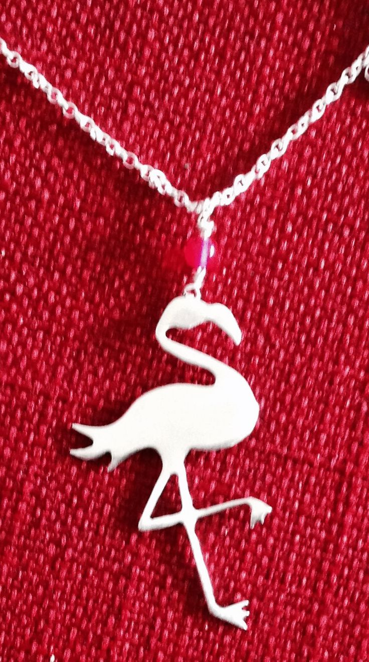 "Made by Helen Green, flamingo cut from silver sheet with pink glass bead on 18"" silver chain."