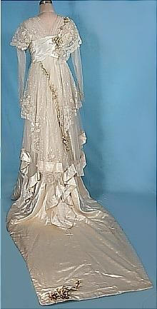 Early 1910s Ecru Satin Trained Wedding Gown with Lace, Wax Orange Blossoms, and Original Veil. Debenham & Freebody, London. (back)
