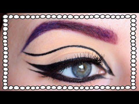 Graphic eyeliner e rossetto blu per carnevale - VideoTrucco
