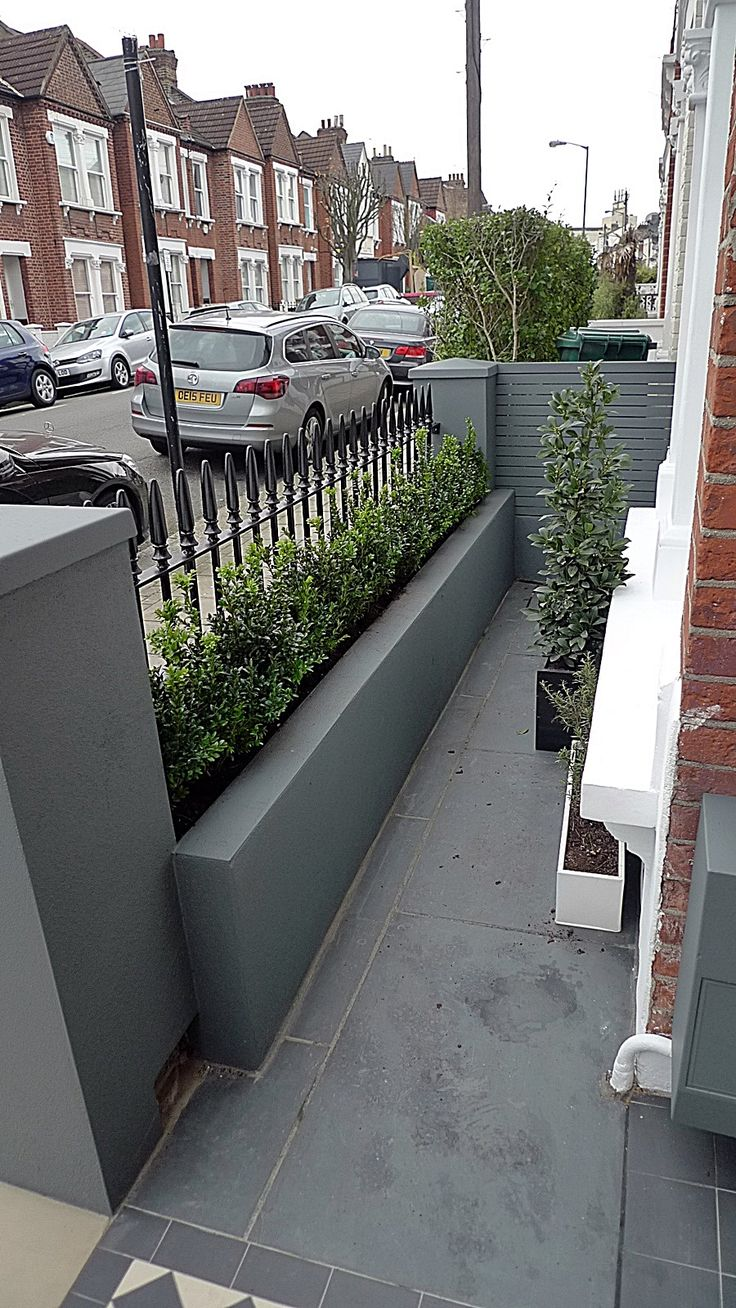 grey walls metal rail tile planting design modern formal balham clapham wandsworth londob - Wall Railings Designs