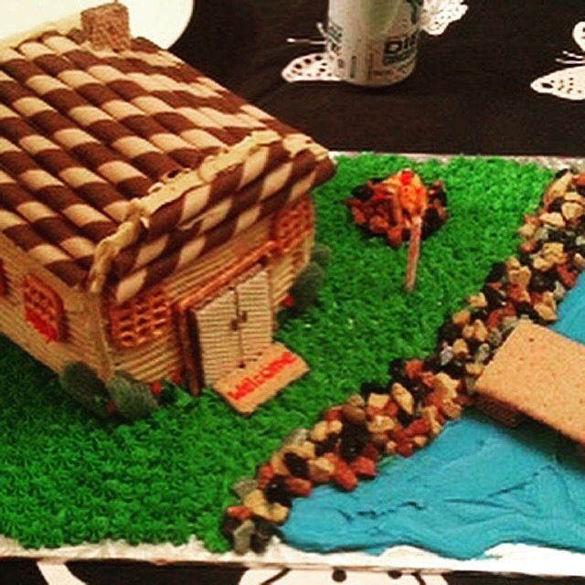 Cabin by a lake cake