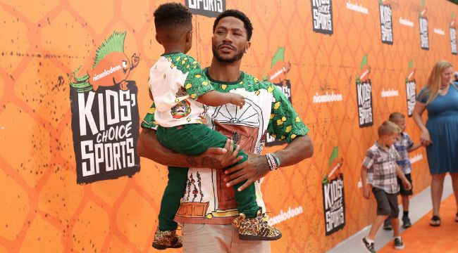 Derrick Rose And His Son P.J. Wore The Same Awesome Shirts To An Awards Show - http://ploud.org/derrick-rose-and-his-son-p-j-wore-the-same-awesome-shirts-to-an-awards-show/