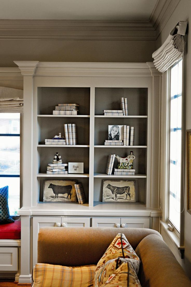 Bookshelves color - Molding On The Bookshelves With Contrasting Color Painted Inside