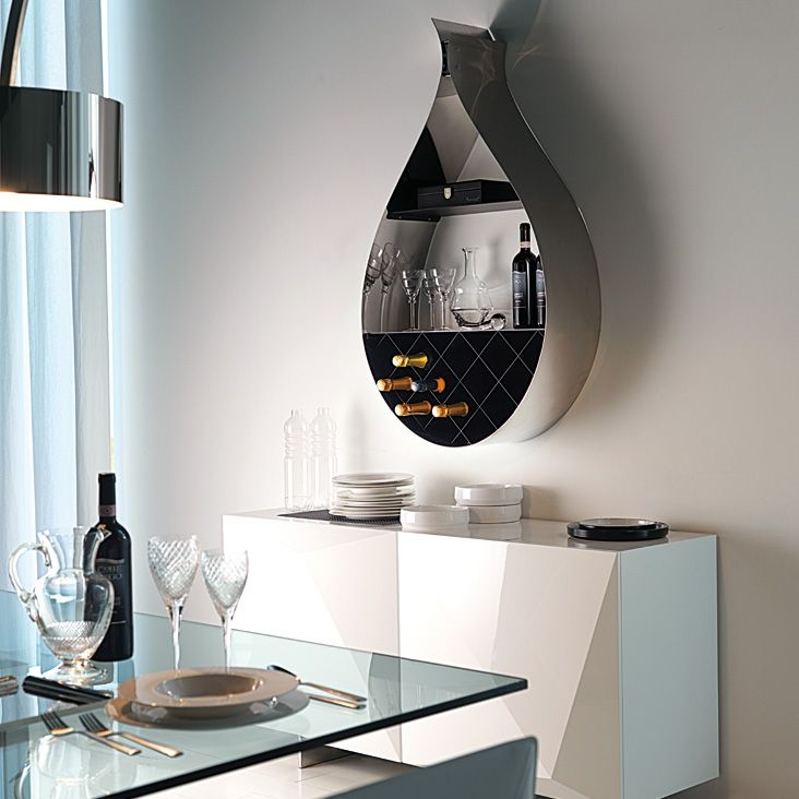 Drop bookcase by CATTELAN ITALIA  Wall bookcase/wine rack in matt white (OP71), black (OP17), graphite (OP69) lacquered steel or in polished stainless steel with rack and shelf in matt white (OP71), black (OP17) or graphite (OP69) varnished steel.  http://www.format-store.com/en/prod/living-area/library/drop-bookcase-by-cattelan-italia.html