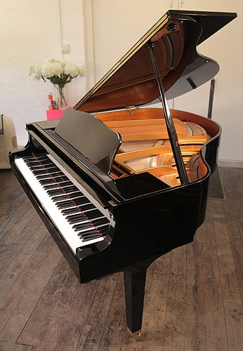 A 1975, Yamaha GA1 baby grand piano for sale with a black case and polyester finish. #yamahapiano  http://www.besbrodepianos.co.uk/piano-sale/yamaha-GA1-baby-grand-piano-black.htm