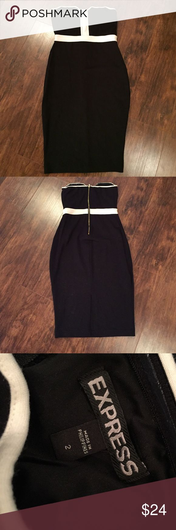 Express black and white bodycon dress Express bodycon dress. Size 2. Worn once for an event. Slit in back of dress. Strapless black and white dress. Express Dresses Strapless