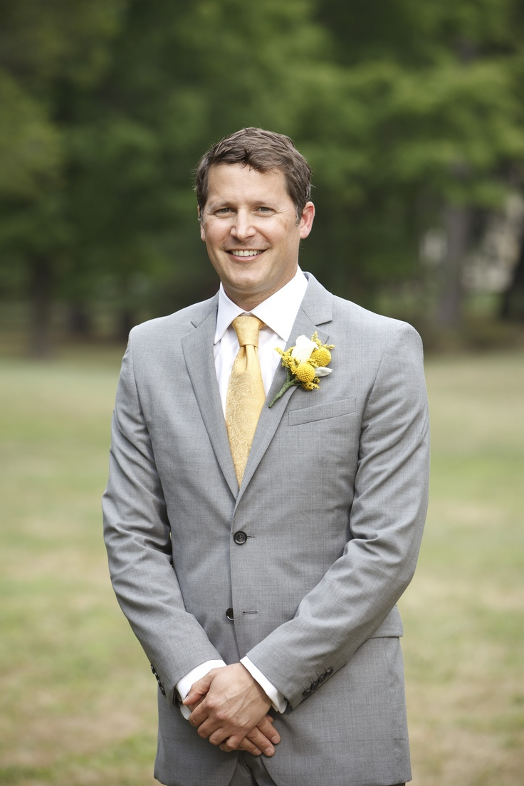 gray suit and yellow tie.