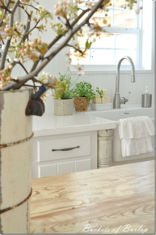 white painted countertops sealed with polycrylic which does not yellow over time like polyurethane can