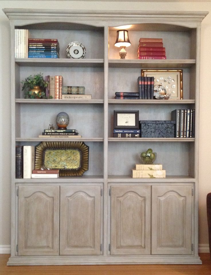 Good bye to the 80's dark wood bookcase, love working with Annie Sloan Chalk Paint!