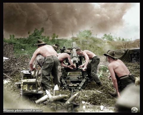 #HistoricPhotoRestoredInColor ....... Australian soldiers of the of the 2/14th Battalion, 21st Brigade, 7th Division, Second Australian Imperial Force, use an Ordnance QF 25-pounder Short field gun to fire on Japanese positions during the Battle of Balikpapan of the Allied Borneo Campaign to oust the occupying Japanese from the island. Balikpapan, Borneo, Dutch East Indies (now, part of East Kalimantan province, Indonesia.) July 1945.