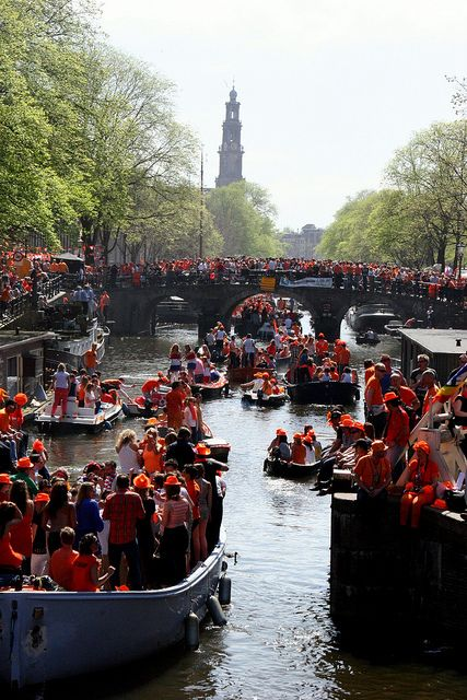 "Queen's Day on the canals in Amsterdam  Koninginnendag (Queen's Day), Netherlands: April 29 or 30 This is a national holiday and a ""free market"" day, so everyone sells everything on the streets. There are games, concerts, performances, and parties on boats in the canals."