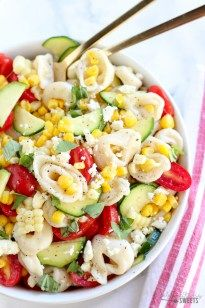 A summery pasta salad filled with cheese tortellini, corn, tomatoes, zucchini and basil topped with a fresh lemon vinaigrette. Serve chilled or at room temperature.