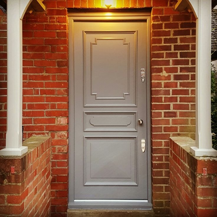 Front door painted in Farrow and Ball moles breath. Fitted with Banham Locks and a Willow and Stone reeded knob.